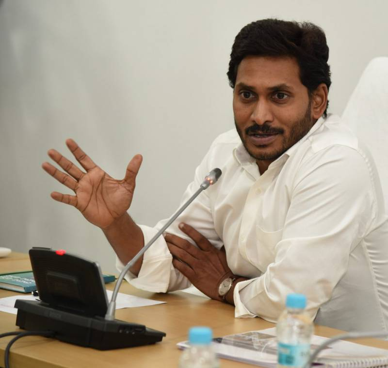 YS Jagan drives away from KIA's first car roll out launch
