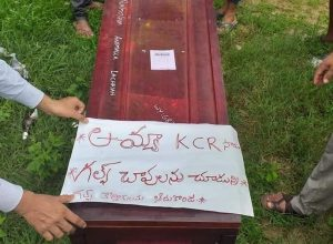 Villagers hold placards during funeral, demand ex-gratia for Gulf migrant workers