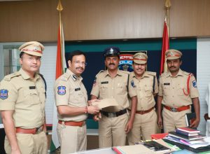 Brave police official rewarded for saving life of an elderly man