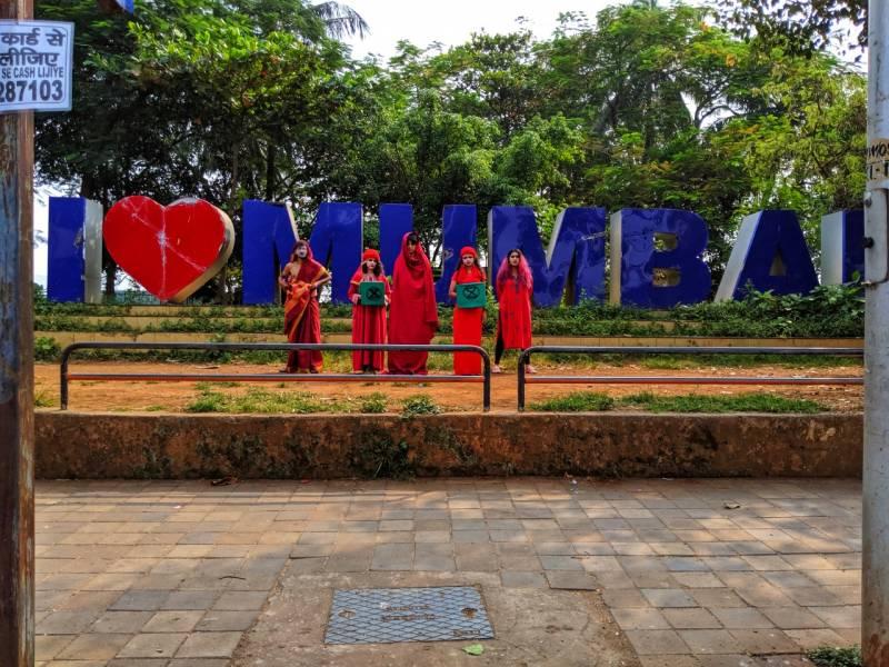 Red Saree Brigade creatively raised their voice against climate injustice in Mumbai
