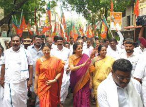 Finance Minister Nirmala Sitharaman wades through water in Chennai