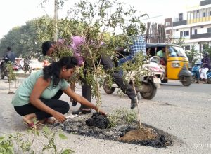 Locals plant saplings in potholes as complaints fall on deaf ears in Hyderabad