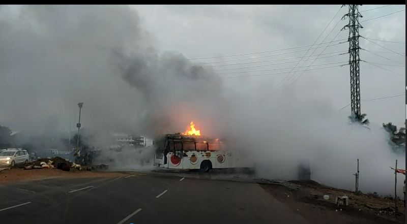 Lucky escape for 45 tourists as bus catches fire post-collision with a truck at Srikakulam
