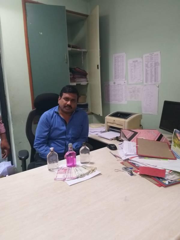 Telangana state transport official caught taking bribe