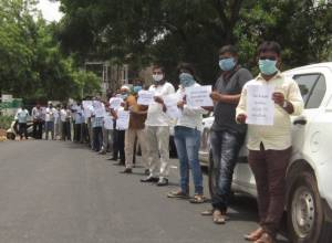 App-based transport workers protest demanding Covid-19 safety gear in Hyderabad