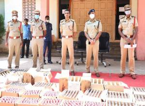 Despite curb on alcohol Guntur police seize non-duty paid liquor worth Rs. 7L