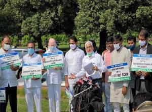 Amaravati Land scam: YSRCP MPs demand CBI probe, protest at Parliament